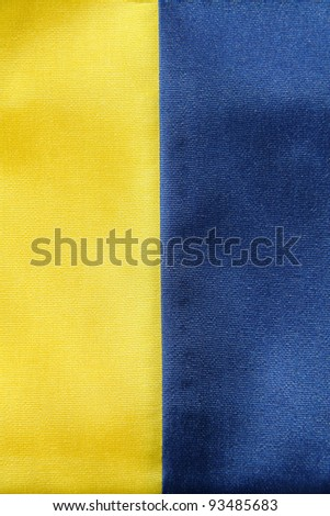 textile ribbon in yellow and blue colors, background photo.