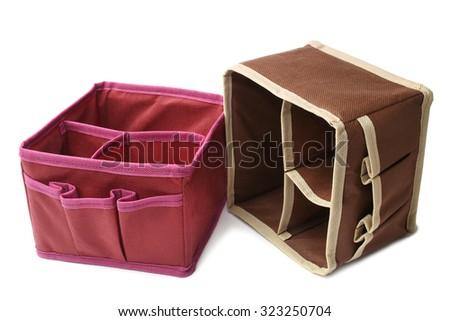 Textile storage boxes on white background - stock photo
