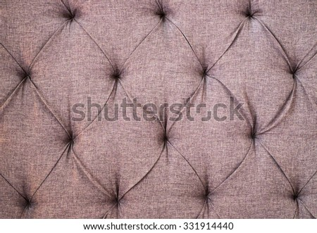 textile upholstery with buttons - stock photo