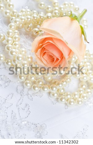 Textile wedding background with rose and pearls
