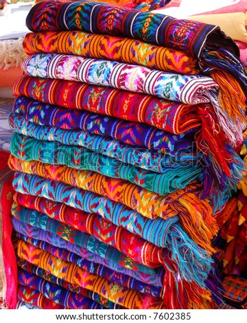 textiles for sale in a market in chiapas, mexico