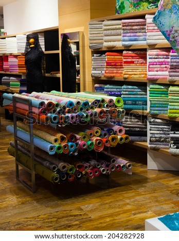 textiles for sale in interior of  shop - stock photo