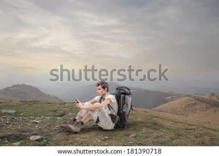 texting in the nature - stock photo