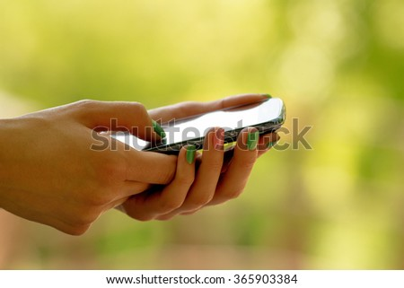 Texting on a smartphone. Shallow depth of field.