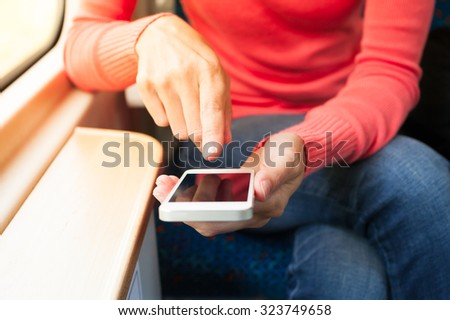Texting on the train. - stock photo