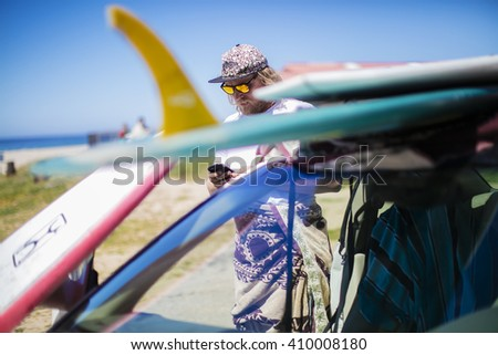 Texting surfer - stock photo