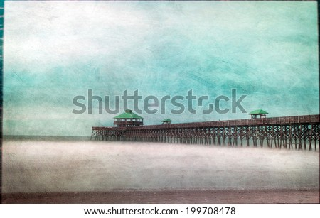 Texture adds an artistic flair to an image of the pier at Folly Beach, South Carolina - stock photo