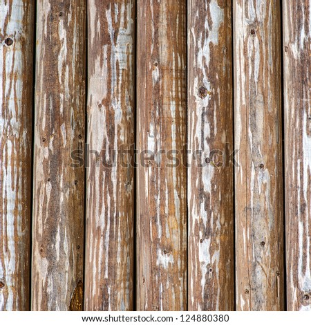 Texture - an old bare fence from wooden boards. - stock photo