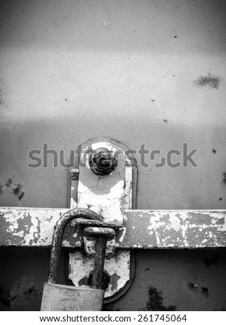 Texture and background of the old lock with rusty on iron box with black and white color - stock photo