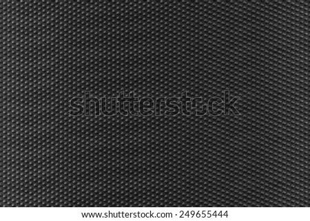Texture background of black pvc vinyl button striped - stock photo