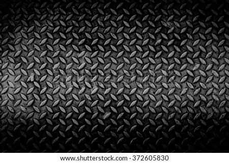 texture background of grungy old weathered  metal diamond plate with scratch and dirty in dark tone - stock photo