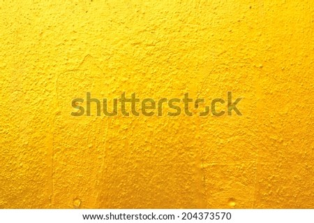 Texture Background of Old Gold Concrete Wall