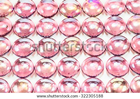 Texture background of pink glass marbles on white background - stock photo