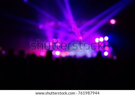 texture blur scene multicolored lights and smoke in concert with silhouettes of peopleBackground for design, blur texture, actors on stage