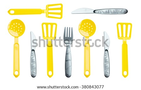 Texture - different children forks, scoop, spoon and knives on a white background