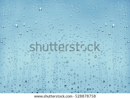 Texture drops of water on the transparent glass background