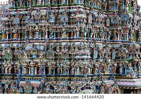 texture formed by the detail of colorful statues of a temple typical of the south of India - stock photo