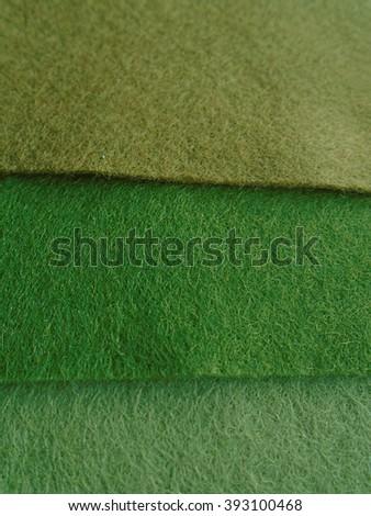 texture green beige mossy felt felting handmade wool fabric  woollen warm materials cloth sewing patchwork background samples soft natural organic raw ethnic folk weaving craft supplies - stock photo