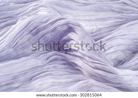 texture lace. a fine open fabric, typically one of cotton or silk, made by looping, twisting, or knitting thread in patterns and used especially for trimming garments. - stock photo