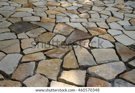 Texture made of many pavement stone bricks. - stock photo