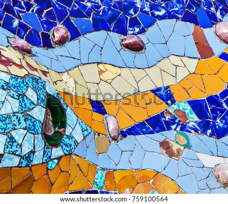 texture mosaic of colored ceramic tile by Antoni Gaudi at his Parc Guell, Barcelona, Spain
