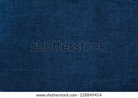 Texture of a background of jeans - stock photo