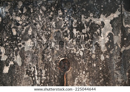 texture of a fire damadged wall - stock photo