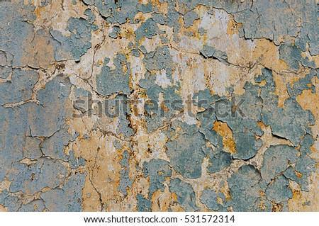 Texture of a gray concrete wall with old peeling oil paint