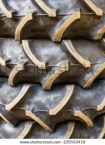 Texture of a heavy vehicle tire thread. - stock photo