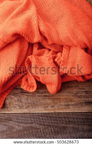 texture of a knitted fabric on a wooden background