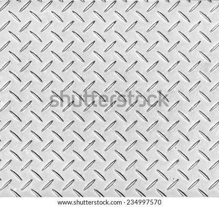 Texture of a metal diamond pattern plate. - stock photo