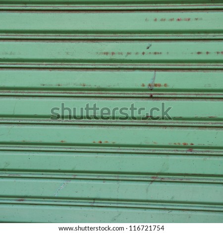 Texture of a metal roller shutter door .