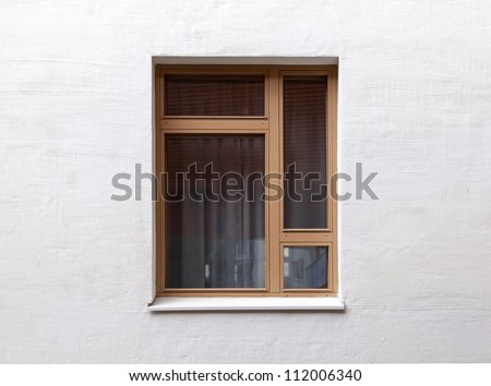 Texture of a modern window on the white wall - stock photo