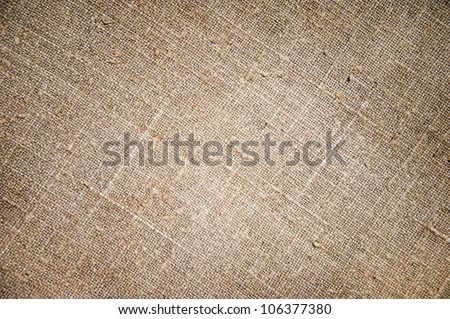 Texture of an old dirty potato sack as background - stock photo