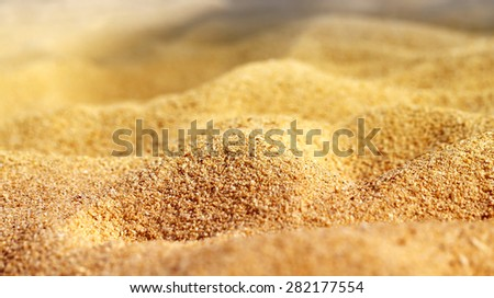 Texture of beach sand is photographed close-up - stock photo