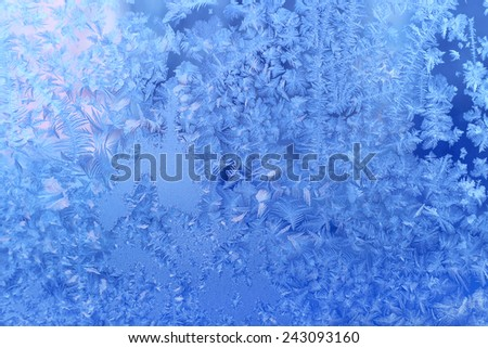 Texture of beautiful natural ice pattern on winter glass - stock photo