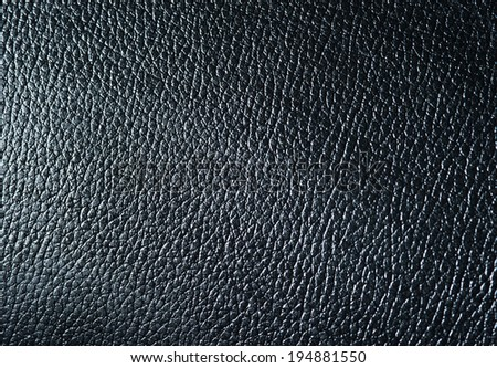 Texture of black skin for an abstract background closeup