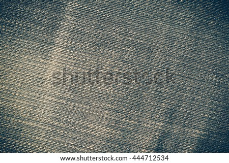 Texture of blue jeans background with filter effect retro vintage style