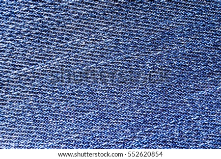texture of blue jeans fabric close up for background