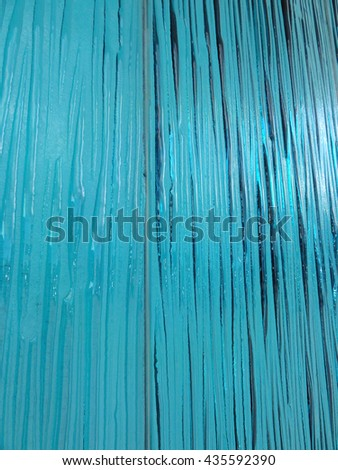 Texture of blue rippled frosted glass                - stock photo