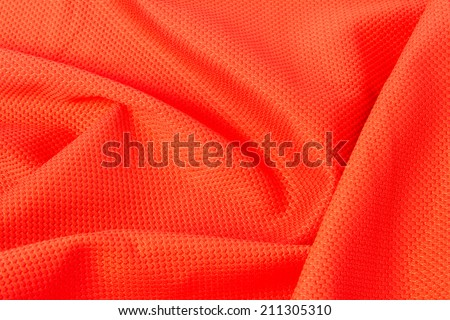texture of bright, acid orange cloth with pleats - stock photo
