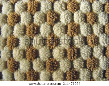 Texture of brown and white relief plush fleecy fabric