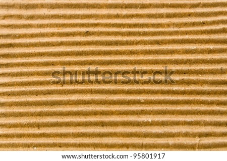Texture of brown corrugate cardboard as background - stock photo