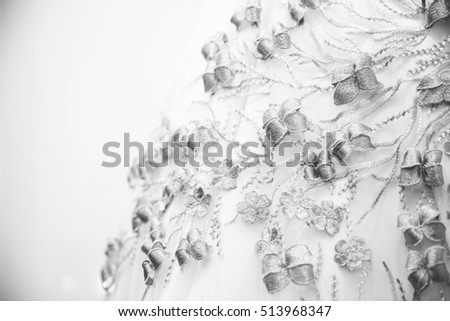 Texture of cloth with details of golden flowers and leaves, luxury material for dress black and white