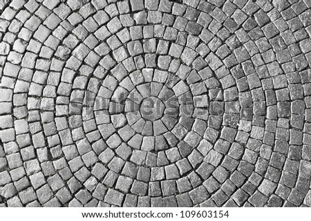 Texture of cobblestone in old town. - stock photo