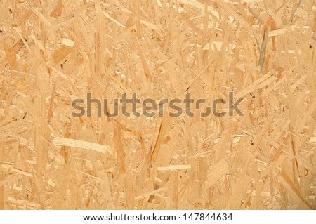 Texture of compressed wood chippings board - stock photo