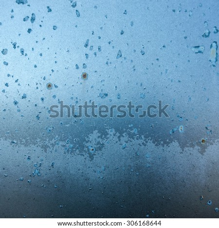Texture of cracked and faded blue paint on metal sheet - stock photo