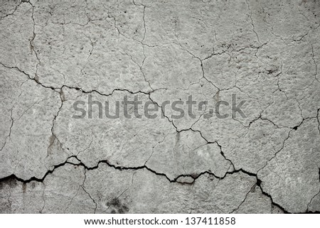 Texture of cracked grey stone wall - stock photo