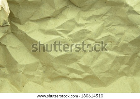 Texture of crumpled craft paper full frame - stock photo