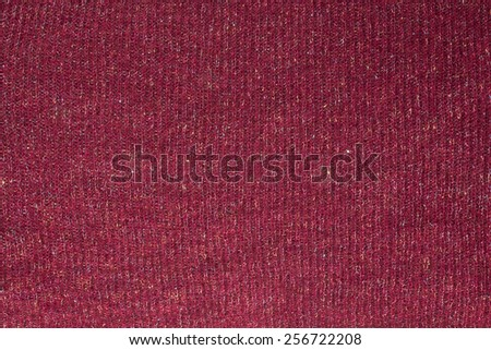 Texture of dark red wool fabric with woven multicolored shiny thread - stock photo